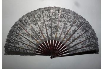 Black flowers, lace fan late 19th century