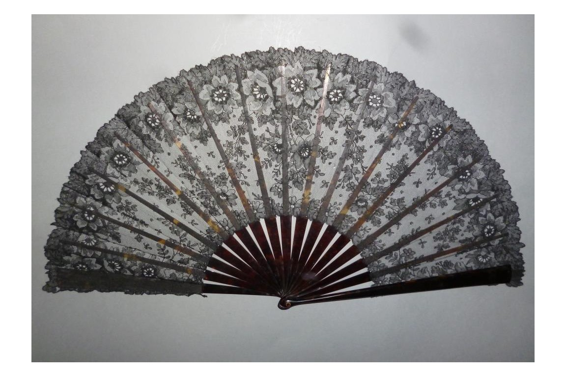 Black flowers, lace fan late 19th century