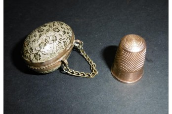 Sewing thimble in an egg, 20th century